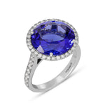 7.90-carat round-cut Violet Blue Tanzanite ring with micro pave weighing 0.81 carats, set in and 18K white gold.