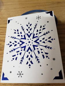 White snowflake card with blue holographic cardstock