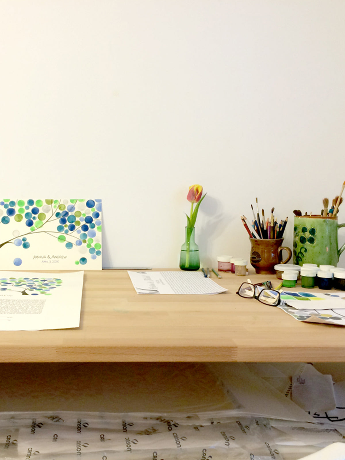 Makings of a matching guest book and ketubah - original greenery in watercolor