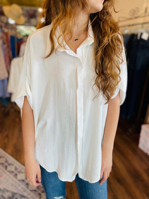 CHAMBRAY BUTTON UP ROMPER
