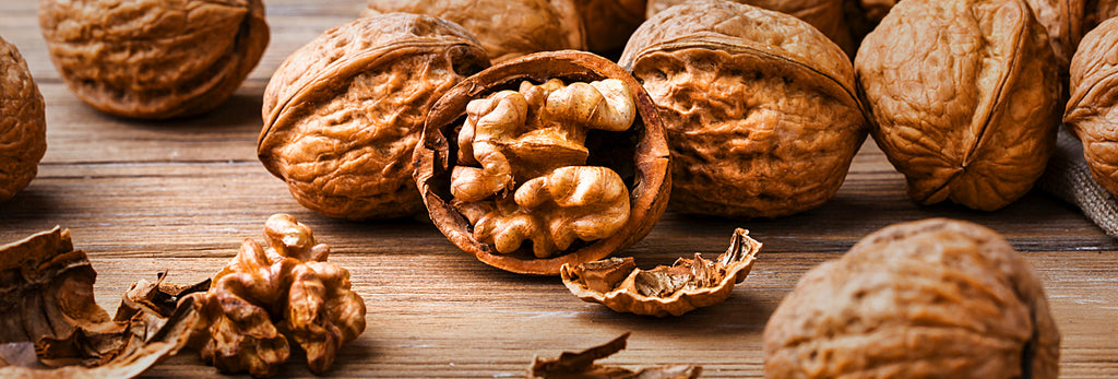 close up picture of walnuts with shells