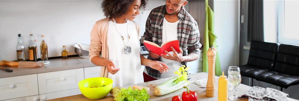 two people in a kitchen cooking
