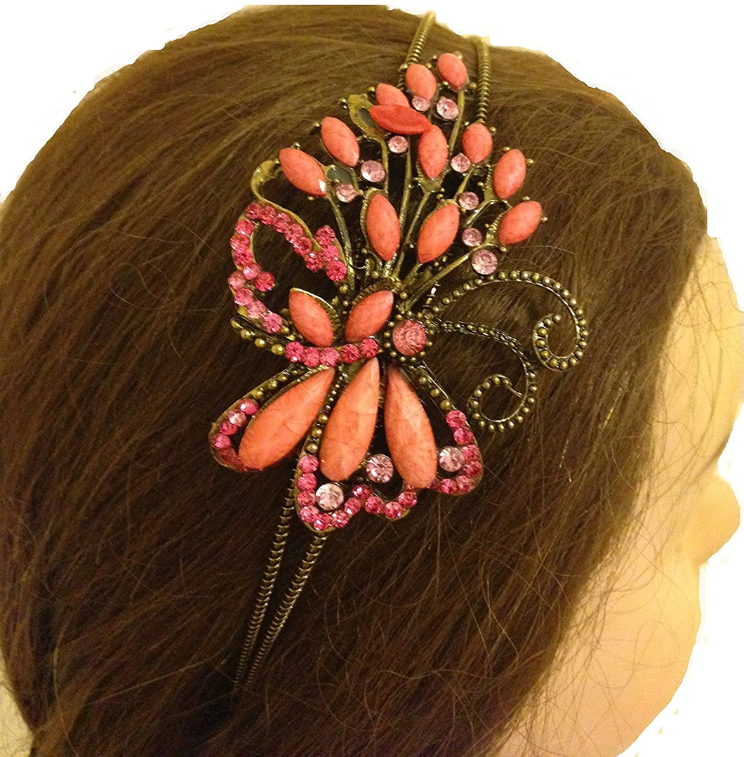 Pink/peach coloured butterfly design aliceband, headband with pretty stone