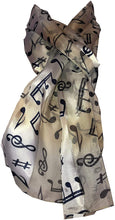 Load image into Gallery viewer, Pamper Yourself Now Gold/Beige Musical Notes Scarf with Blue Notes