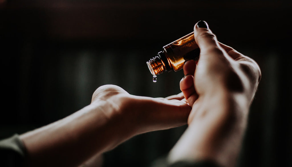 Drop of essential oil on hand