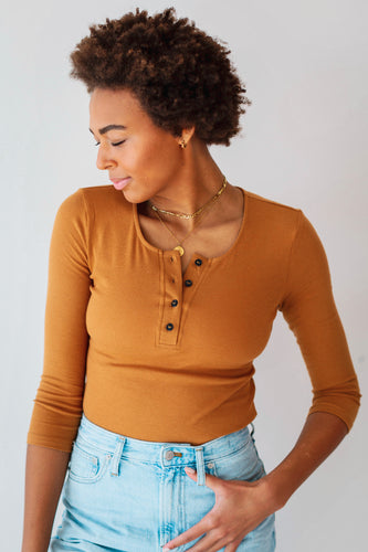 Basic Ribbed Bodysuit  Our Basic Ribbed Bodysuit is ribbed to flatter and feel divine on your skin while still allowing a little stretch. Wear it under our jackets, with jeans or skirts. The perfect basic to have in your closet to dress up or go for a more casual every day to day look.
