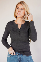 Load image into Gallery viewer, Basic Ribbed Henley Top  Our long sleeve ribbed henley is the perfect basic to style or wear alone. Its classic style features a button front closure, and a slim fit. This top's cool feel will keep you comfortable--even on warmer days! Based on the trending look of textured pieces, this henley is ideal for taking your look from day to night. Pair it with denim jeans for a laid-back date night in the city, or dress it up with your favorite pair of slacks for heading to work or an after-work event.