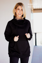 Load image into Gallery viewer, Cowl Neck Pullover  Add a layer of warmth to your looks with our Cowl Neck Pullover. Its super soft brushed inner lining and sleek high cowl neck in a criss-cross design make this a great option for layering beneath a jacket or chunky sweater to add an extra layer of warmth. Long sleeves and the kangaroo-style front pocket also add to its sophistication.