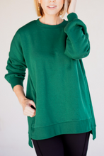 Load image into Gallery viewer, Hi-Low Hem Sweatshirt  The fabric and fit of our Hi-Low Hem Sweatshirt is designed to provide comfort and ease, whether you are relaxing on your couch, or in the park with friends. It has a loose fit that allows you to move freely, in any situation. Even better it has pockets for versitlility. Open up your closet and find comfort. A perfect staple sweatshirt to have in your wardrobe.