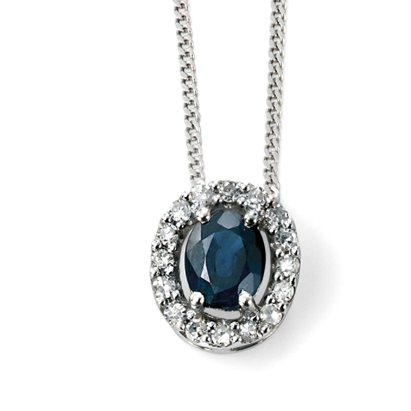 A 9Ct White Gold Blue Sapphire And Diamond Cluster Pendant Part Of The Norwich Jewellers Hemstocks Range