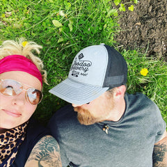 Rebecca and justin on grass with dandelion