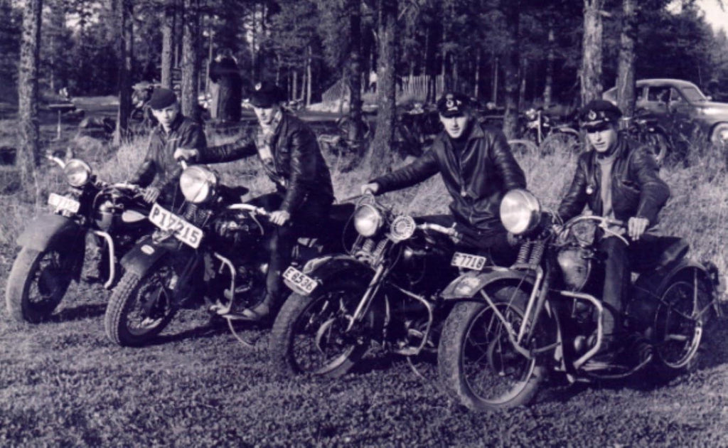 Leather Lads from Sweden posing for a picture with their bikes.