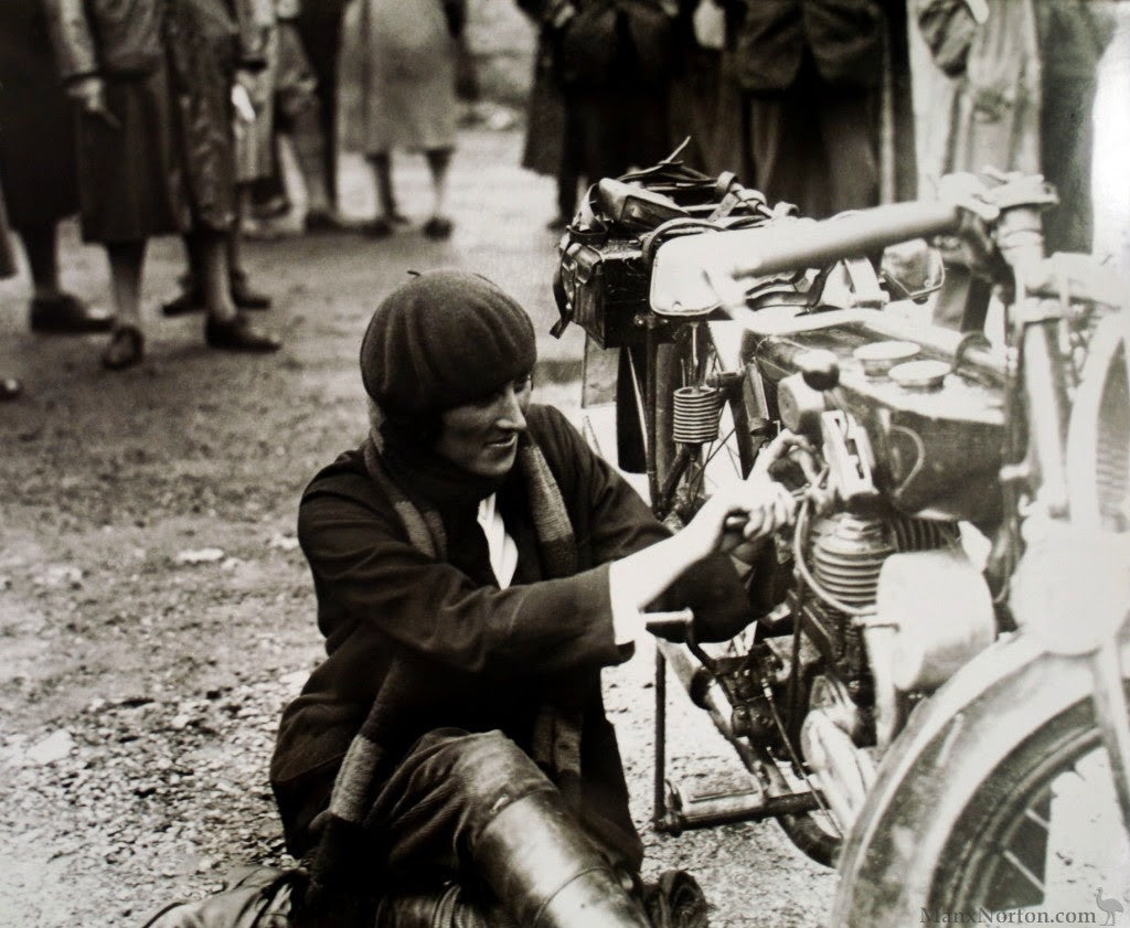 Marjorie Cottle fixing her motorcycle in 1926