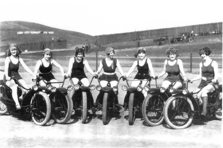 1920s women ner-a-car riders posing for a picture