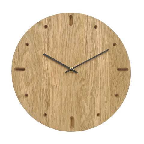Amasova - wooden wall clock • Light oak wood with ovals and circles