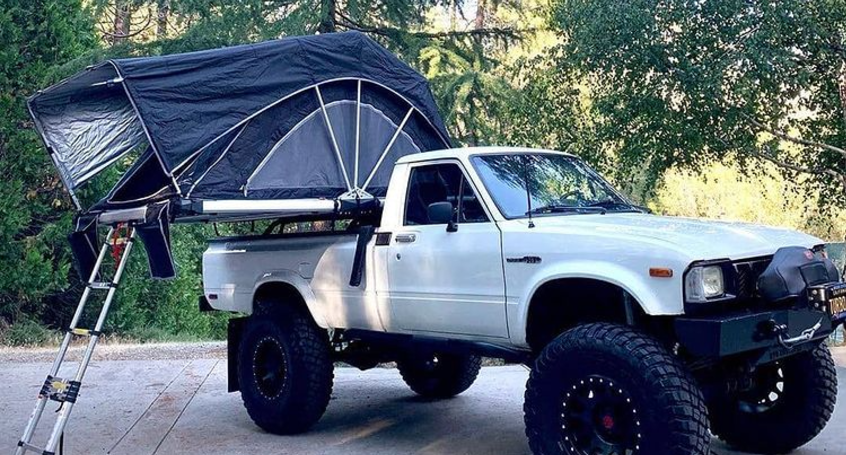 freespirit recreation high country 80 roof top tent lifestyle image on truck