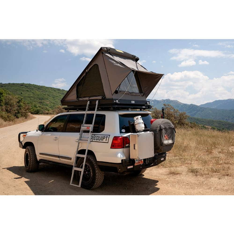 Eezi-Awn Blade Hard Shell Roof Top Tent For Sale On Car Left Side Lifestyle Image