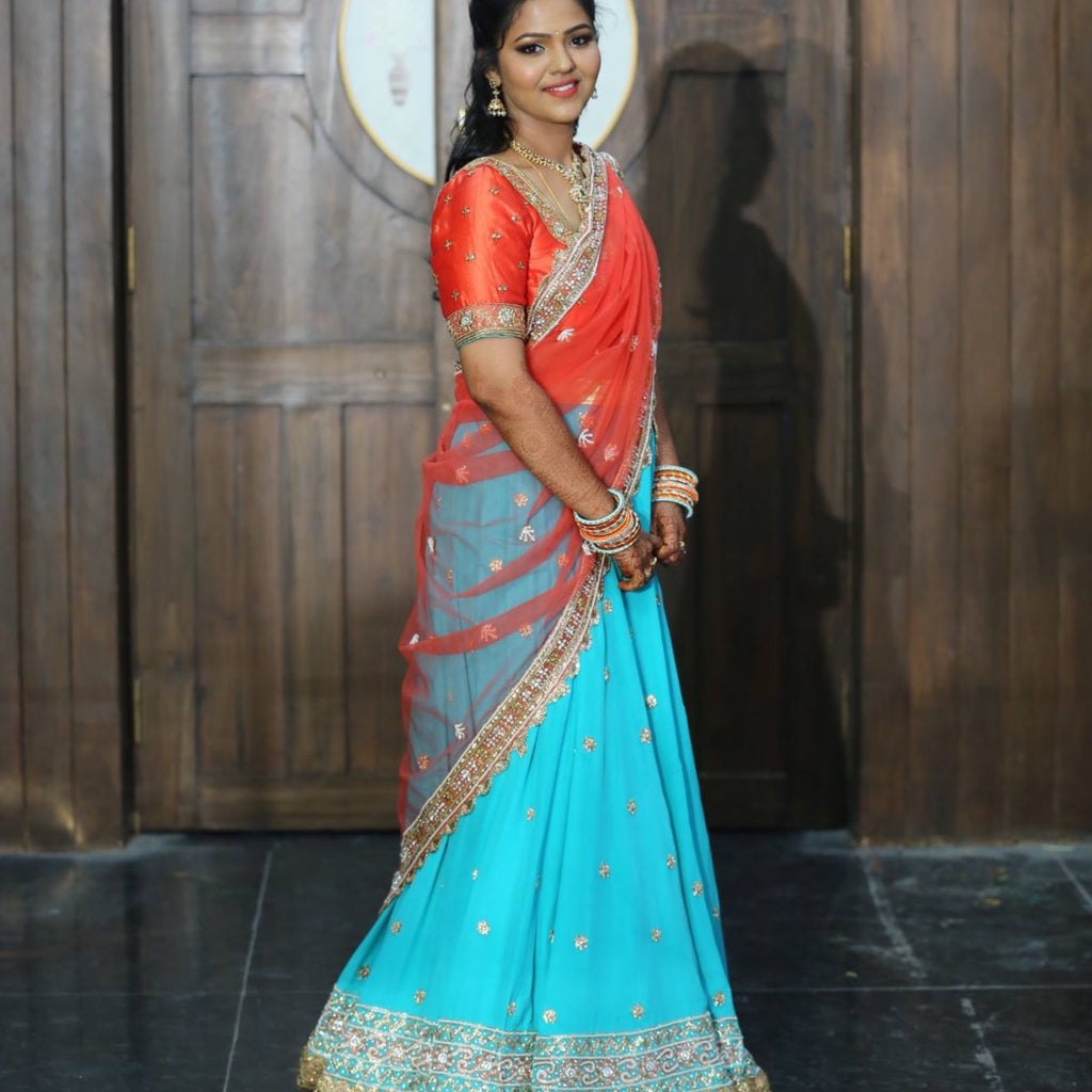coral and blue lehenga