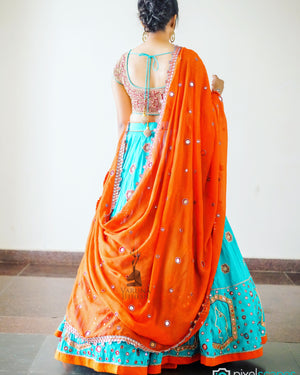 Orange sea green lehenga