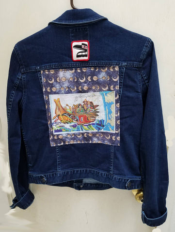 Wearable Art Jeans Jacket (Calvin Klein) with Canoe Journey and Raven Patch Application