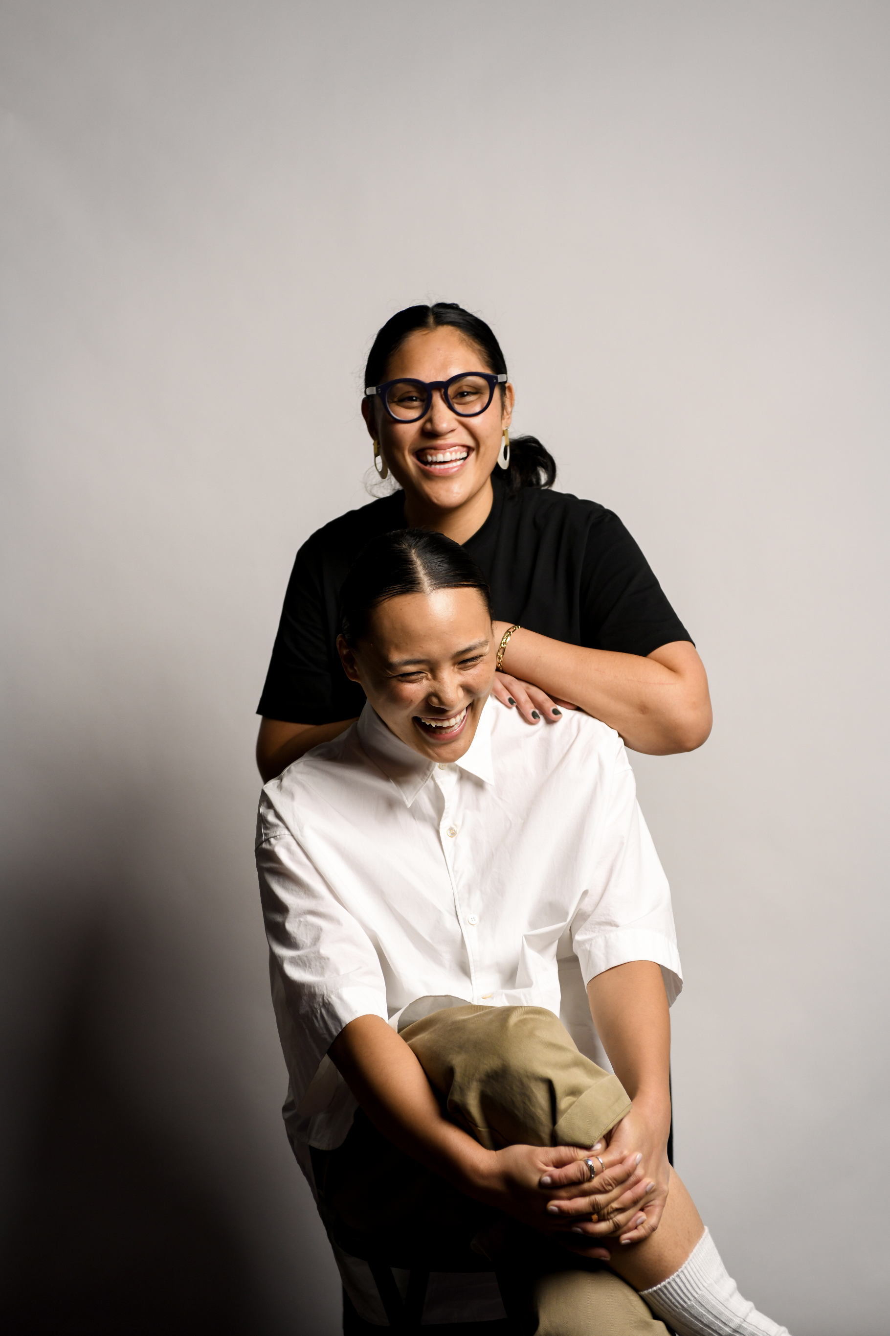 Women asian BIPOC co-founders of independent boutique MUKAEMUZ