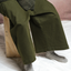 Person seated wearing the Mónica Cordera Chunky Cotton Pocket Pants in Green