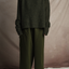Person standing wearing the Chunky Cotton Pocket Pants in Green and Soft Alpaca Knit Sweater by Mónica Cordera