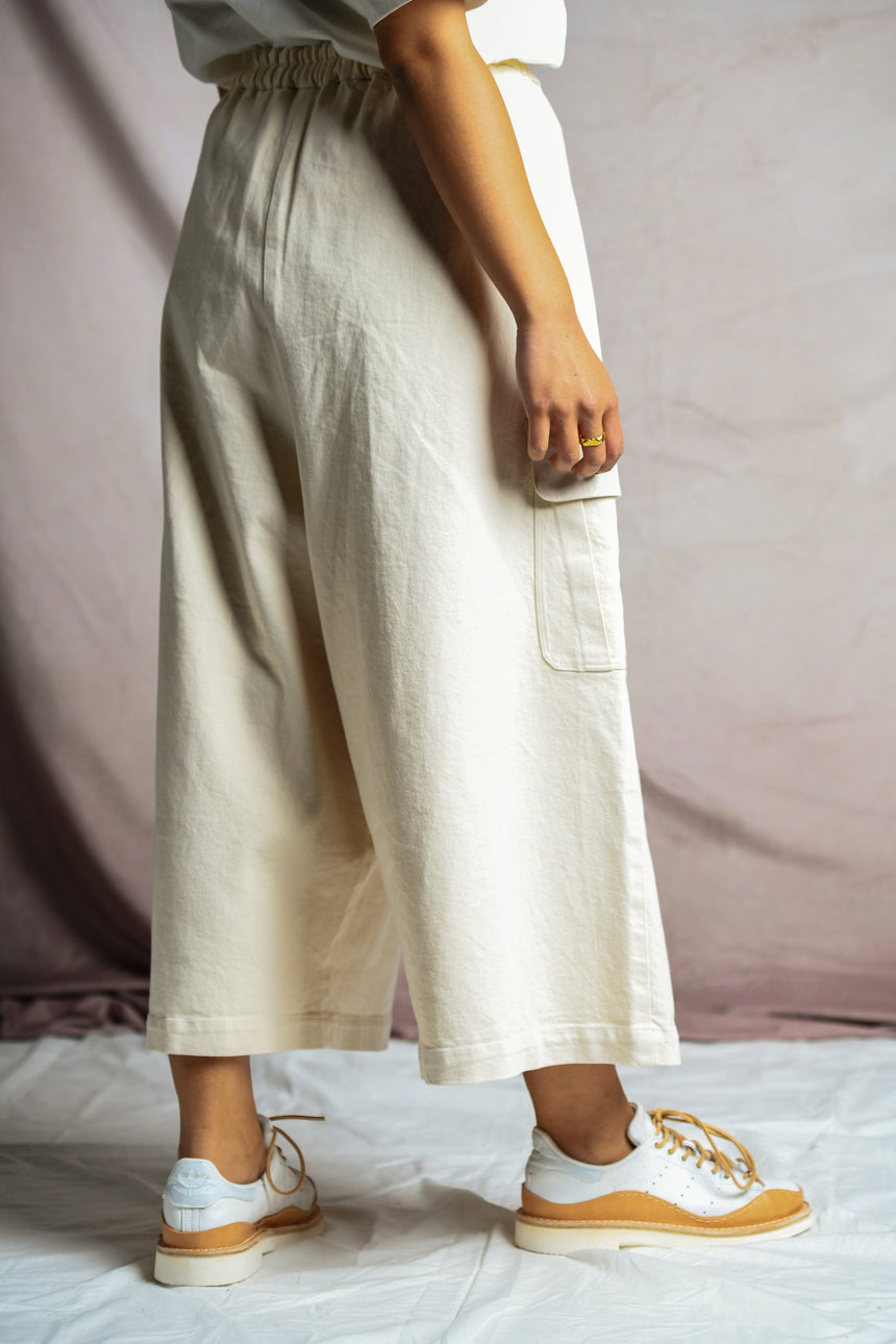 Rear view of person wearing Mónica Cordera Chunky Cotton Pocket Pants