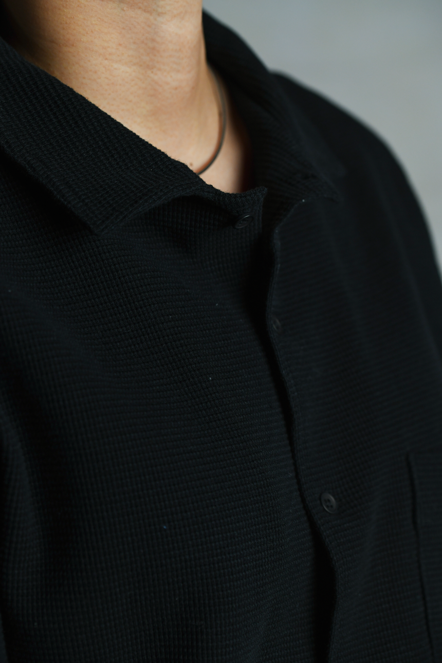 Collar and button details of OFTT Waffle Shirt in black.