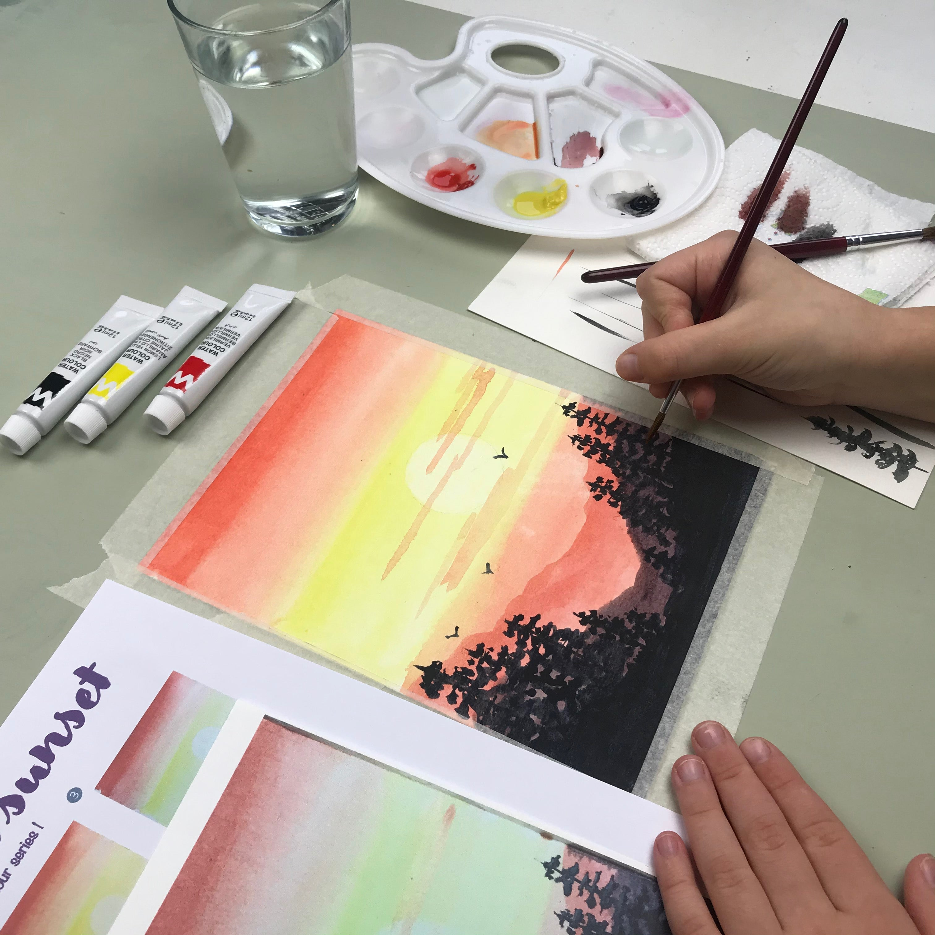 Child painting with watercolour