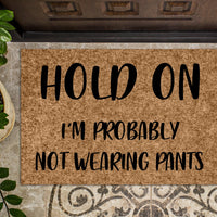 Hold On I'm probably not wearing pants Funny Door mat