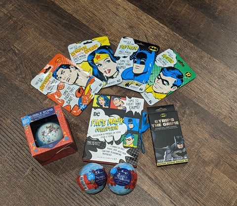 superman, batman, wonder woman, and robin face masks, pore strips, and bath bombs.  Check out All our new products!