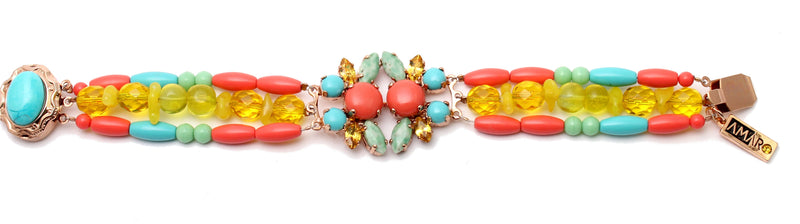 wide colorful braclet with a center stones element
