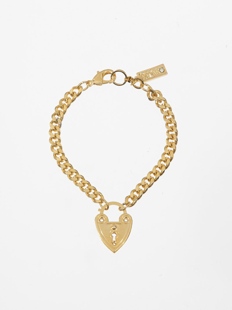 Heart lock bracelet- a rough gourmet bracelet with a hanging heart lock. The bracelet is plated with a high quality plating of 24K yellow gold.