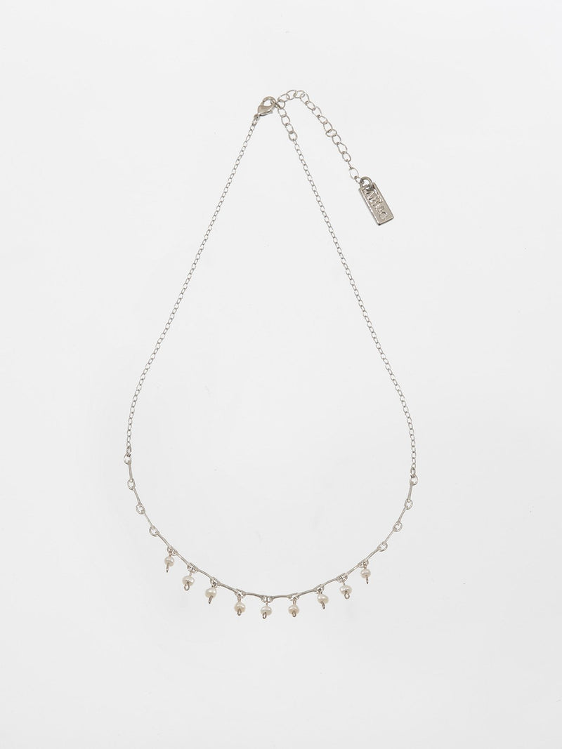 Lily necklace - a thin and delicate necklace with 10 tiny pearl beads hanging in the center.