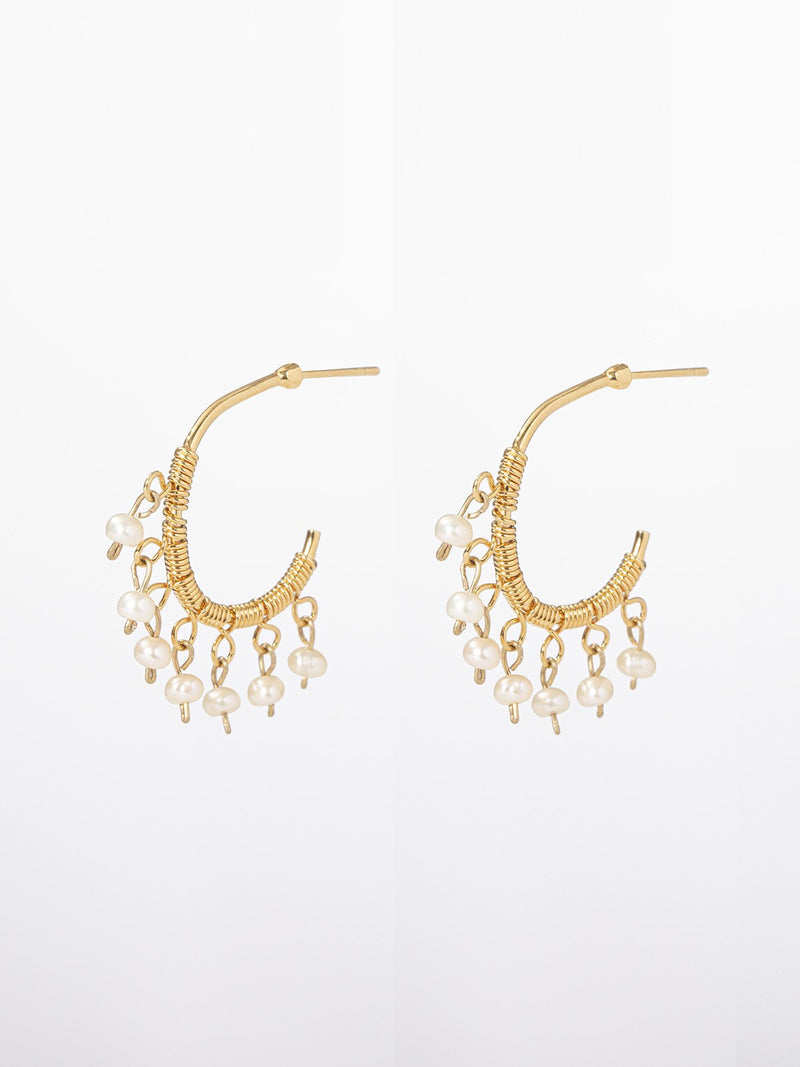 Thea earrings- Delicate hoop earrings with seven dangling tiny pearls. The earrings are of 24K yellow gold plated. hoop diameter: 2cm.