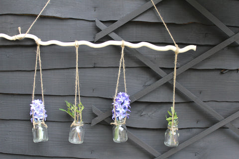 Hanging Bottles On Branch