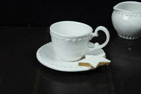 Ceramic White Teacup And Saucer