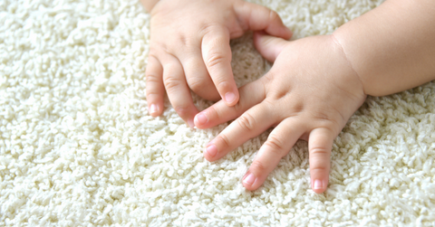 Baby hands on carpet