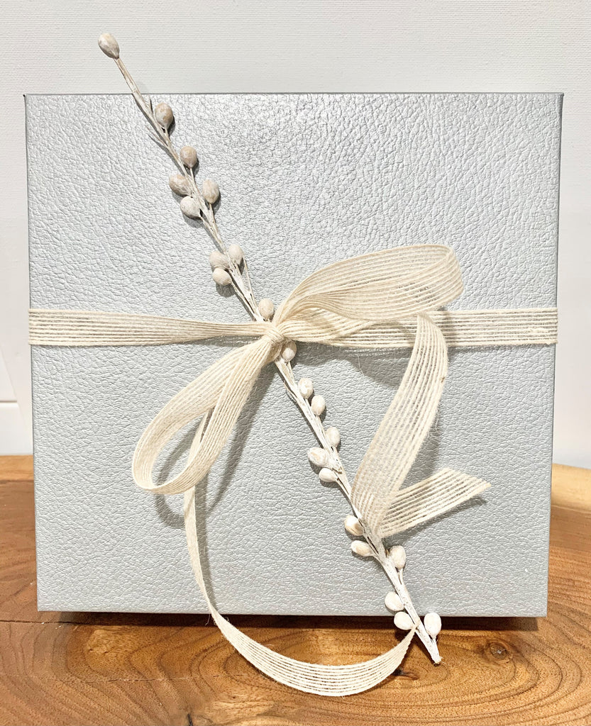Gift box lid with bow and floral stem