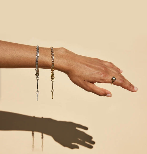 Gold and silver bracelets on arm