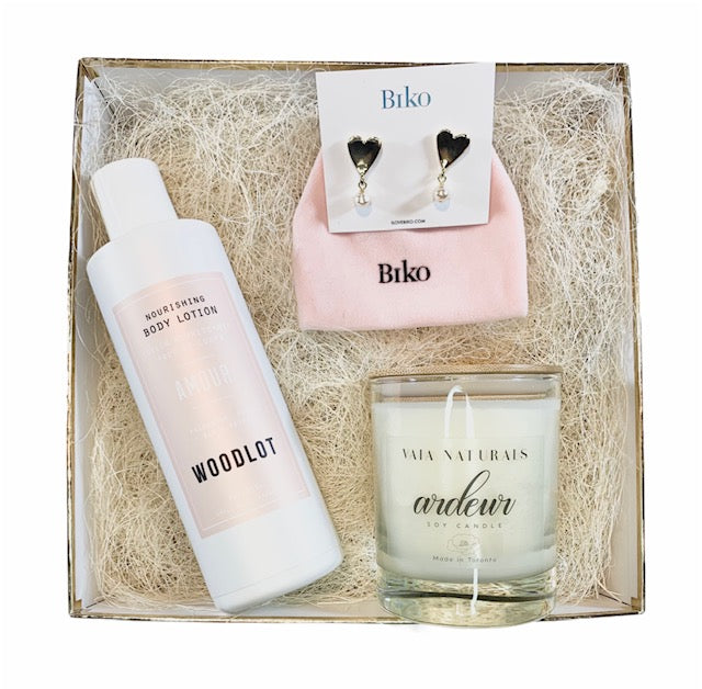 Gift box with body lotion, candle and heart earrings.