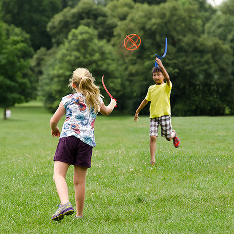 two children play catch outside with a Jabbit toy set