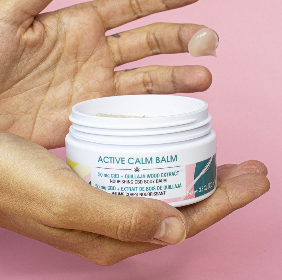 Woman holding Active calm balm in her hands
