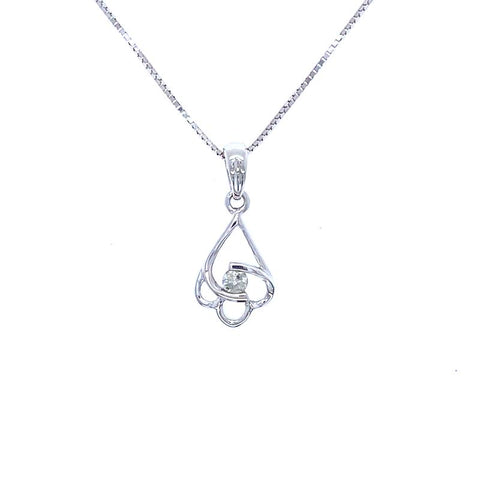 A floral pendant on a chain in white gold