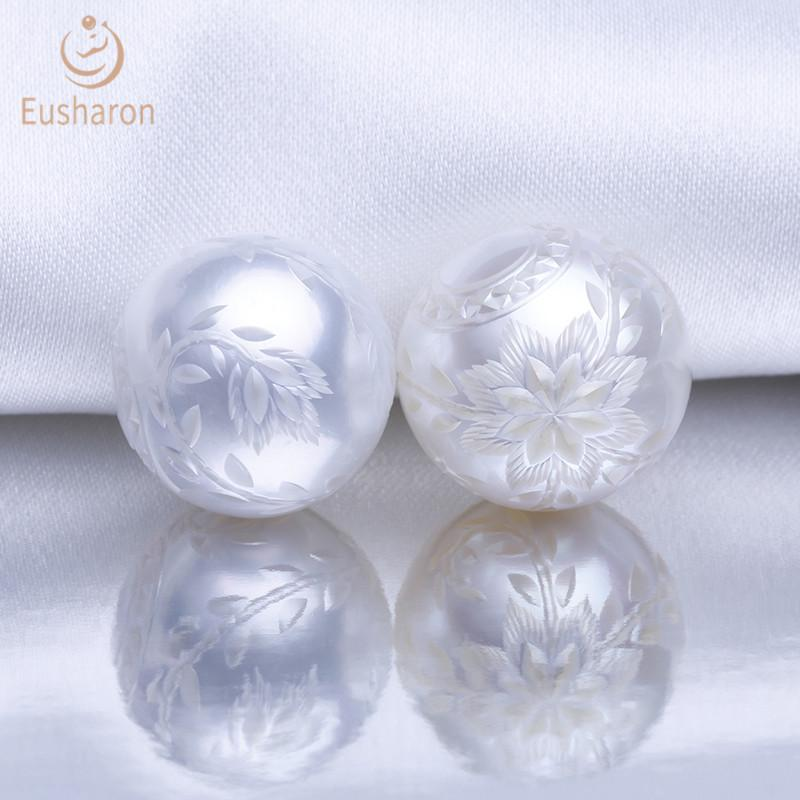 carved round white south sea pearl