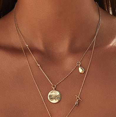 Wanderlust + Co See The World Gold Mantra Necklace