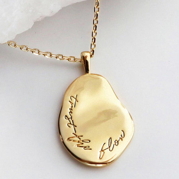 Wanderlust + Co Trust The Flow Gold Mantra Necklace