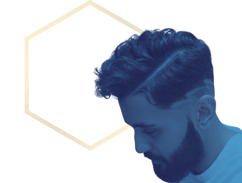 men hairstyle textured wavy hard side part with hair tattoo bearded man