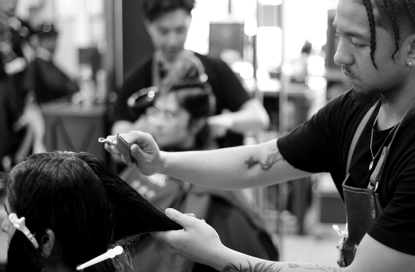 Hair school students working on clients